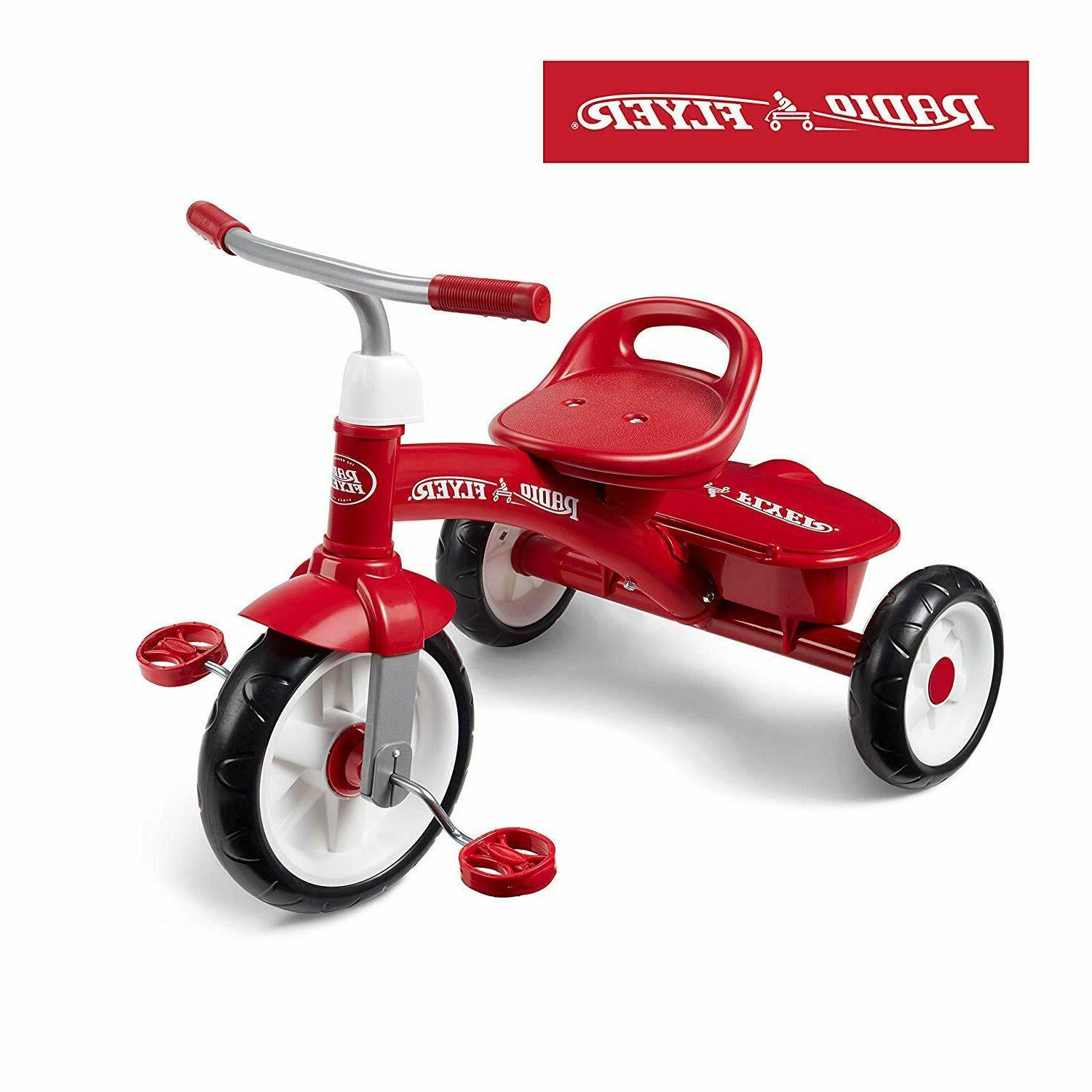 red tricycle triciclo trike bike rider kids