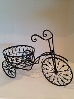 Vintage Tricycle Wrought Iron Plant Stand is the perfect dec